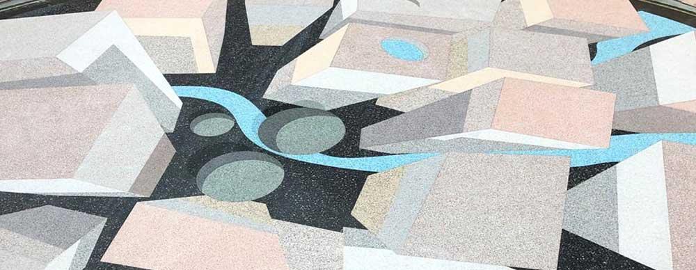 Pavimento in resina con ciottoli e granulati